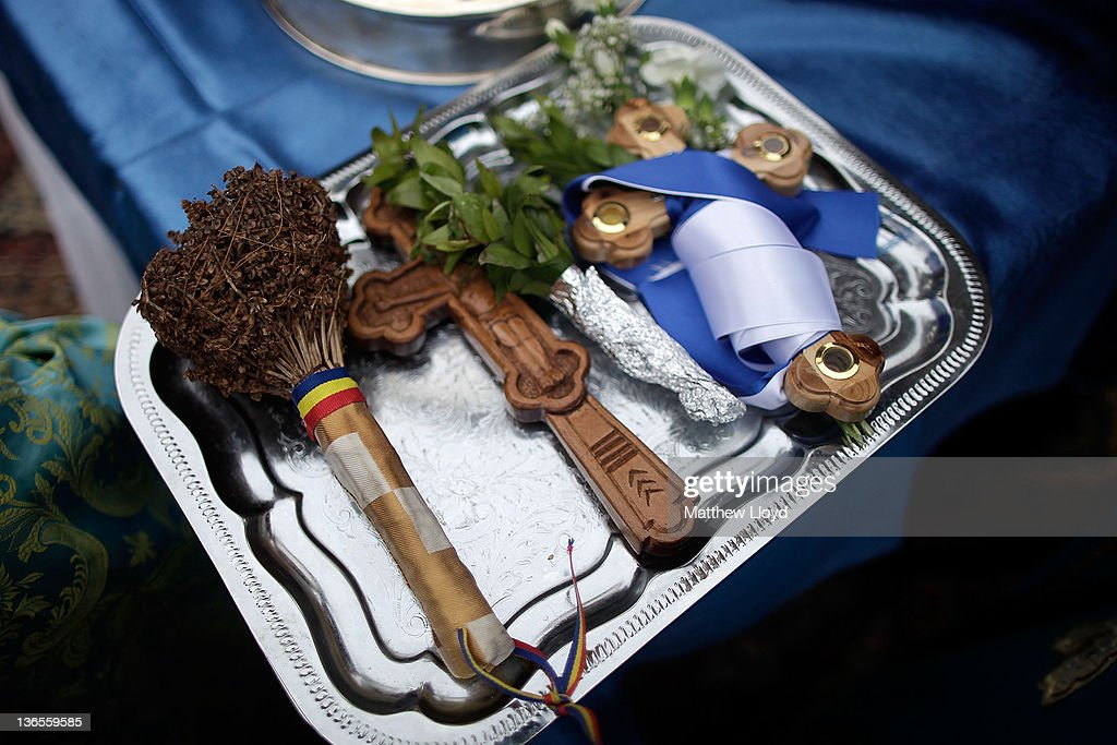 Crucifixes lie on a plate before being blessed as Greek Orthodox clergy hold a service on Margate beach on the Feast of the Epiphany on January 8...