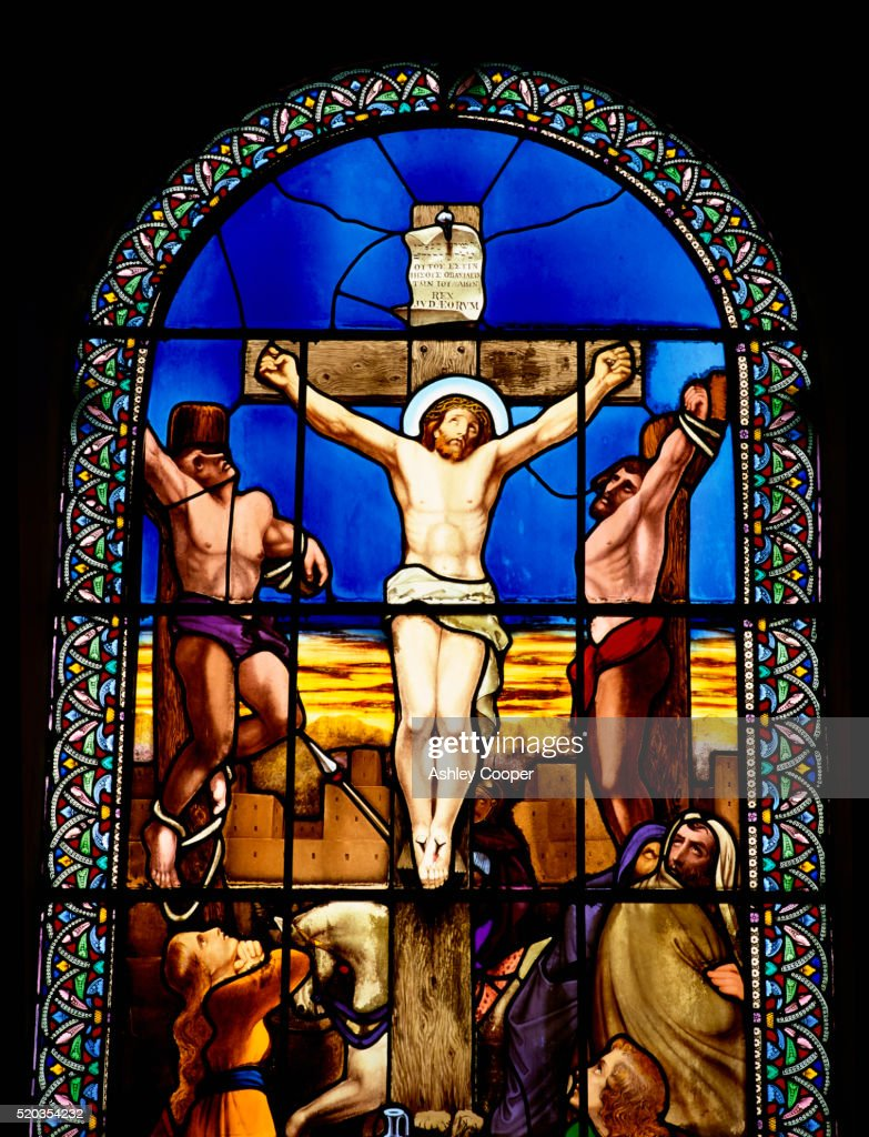 crucifixion of jesus christ stained glass window stock photo