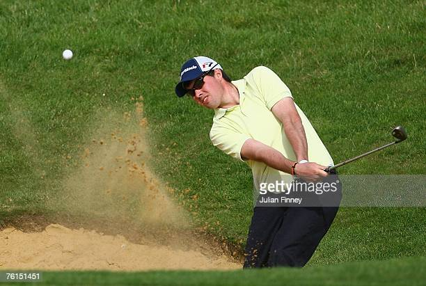 Crue Elliott plays out of a bunker on the 18th during the PGA Powerade Assistants Championship at the London Club Golf Course on August 17 2007 in...