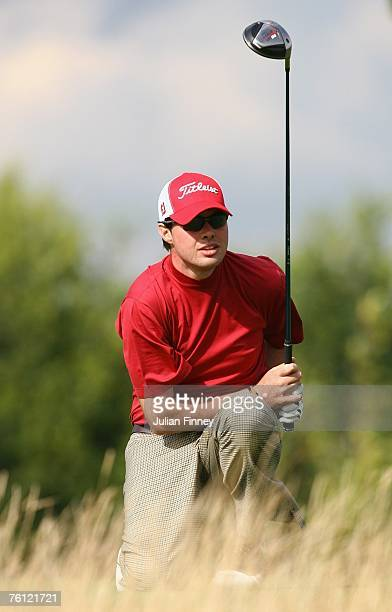 Crue Elliott watches his shot on the 1st tee during the PGA Powerade Assistants Championship at the London Club Golf Course on August 15 2007 in...