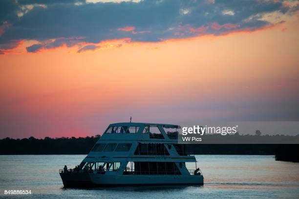 Cruise along the Victoria Falls aboard the ' African Queen' Other boats sailing in the Zambezi River Take a Sunset Cruise down the mighty Zambezi...