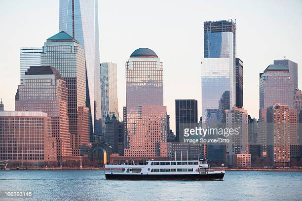Cruise boat by New York City skyline