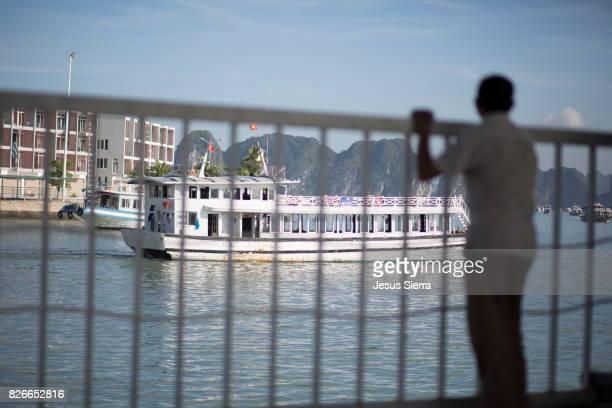 Cruise boat in Dao Tuan Chau harbour, Halong Bay.
