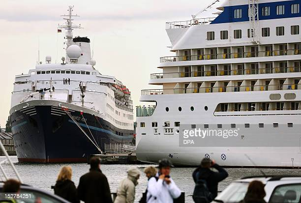 Cruise liners 'Marco Polo' and 'AIDAblu' lay at the port of Warnemuende near Rostock northeastern Germany on September 26 2012 The Baltic Sea port...