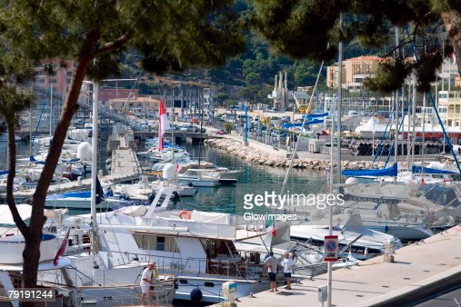 Cruise ship and boats docked at a harbor, Monte Carlo, Monaco : Stock Photo