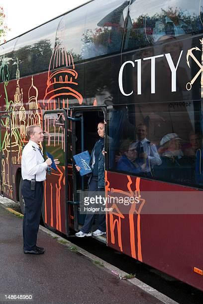 Cruise ship MS Astor excursion staff at tour bus.