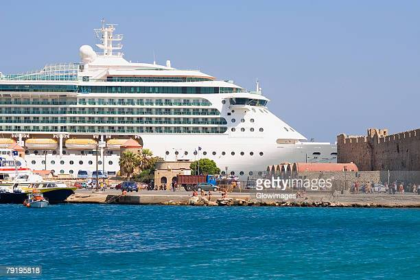 Cruise ship at a harbor, Mandraki Harbor, Rhodes, Dodecanese Islands, Greece