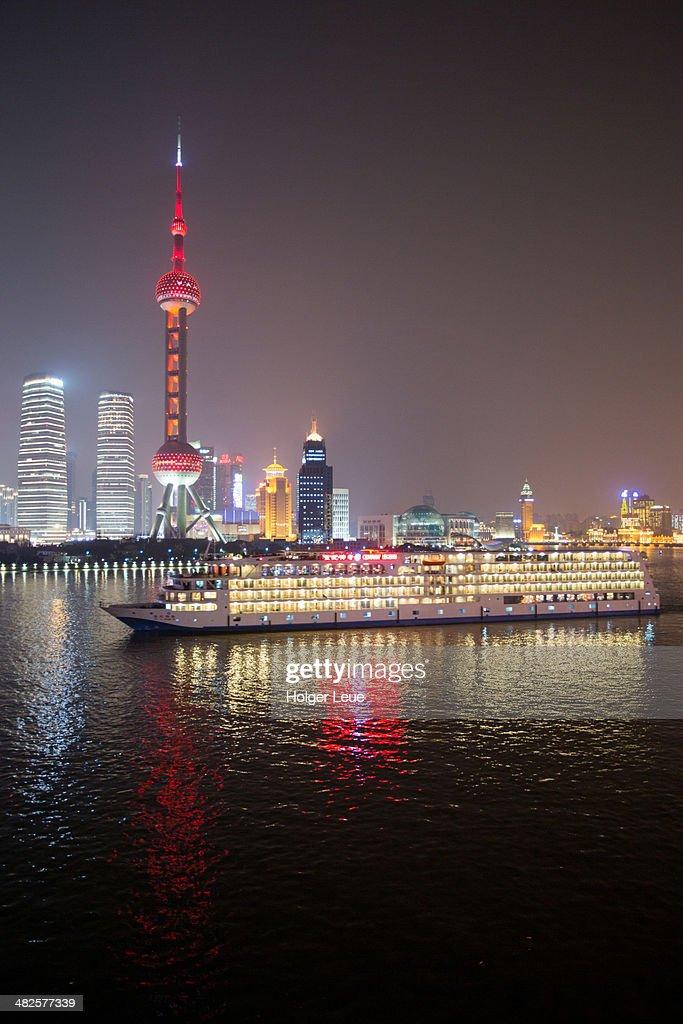 Cruise ship Century Legend and skyline at night