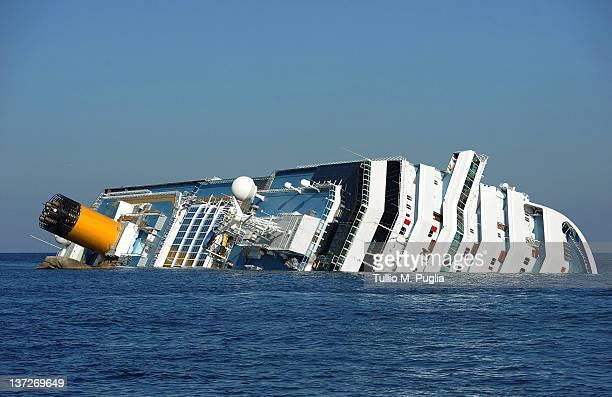 Cruise ship Costa Concordia lies stricken off the shore of the island of Giglio at Giglio Porto on January 18 2012 in Giglio Porto Italy The official...