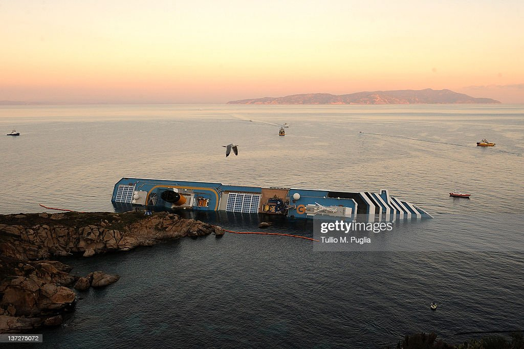 Cruise ship Costa Concordia lies stricken off the shore of the island of Giglio on January 18 2012 in Giglio Porto Italy The official death toll is...