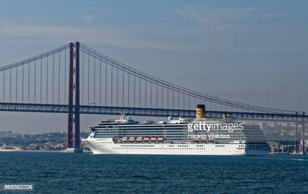 Cruise ship Costa Mediterranea sails the Tagus River by the 25 de Abril bridge on October 31 2017 in Lisbon Portugal Although active all year round...