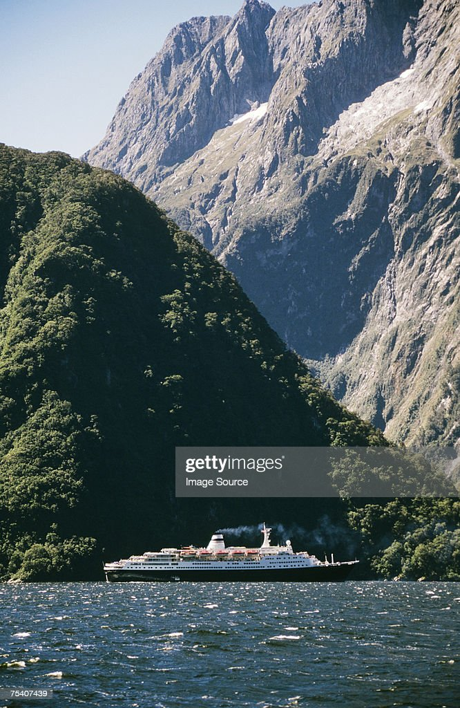 Cruise ship in milford sound : Stock Photo