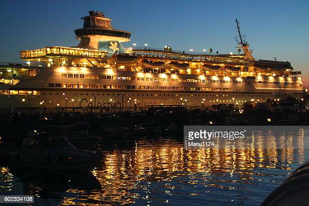 cruise ship in the evening light of mykonos