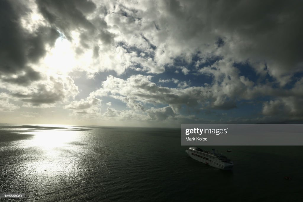 A cruise ship is seen in place off Port Douglas for passengers to watch the total eclipse on November 14, 2012 in Cairns, Australia. Thousands of eclipse-watchers have gathered in part of North Queensland to enjoy the solar eclipse, the first in Australia in a decade.