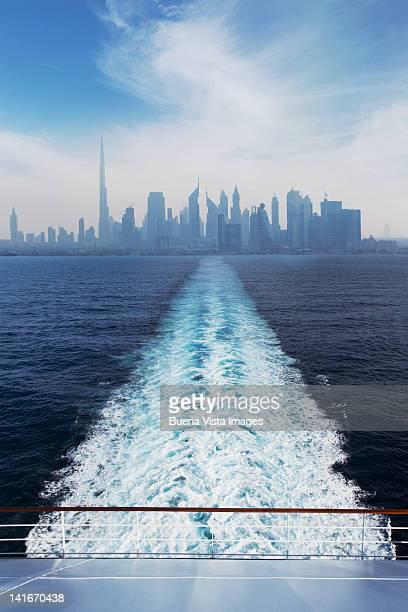 Cruise ship leaving a big city