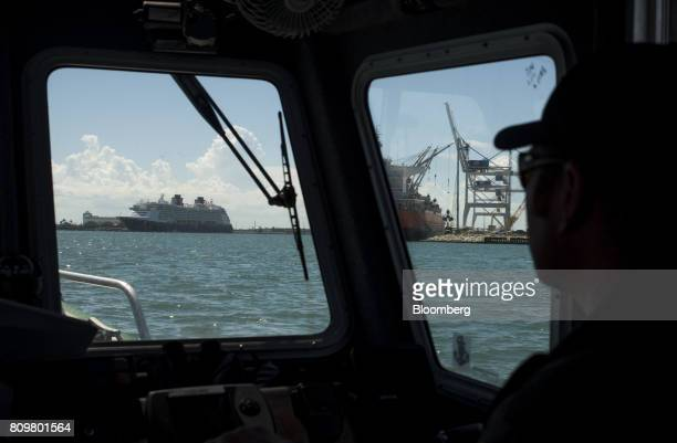 A cruise ship left and the Starry Sky bulk carrier ship can be seen from the windows of a patrol boat at Port Canaveral in Cape Canaveral Florida US...