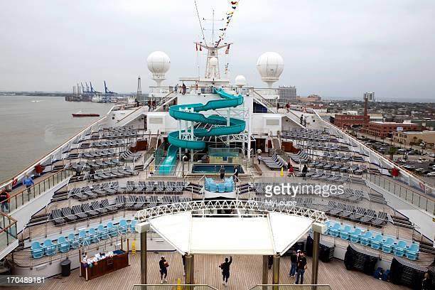 Cruise ship Lido deck with sun and swimming pool before the cruise with the first few passengers on board Cruise out of Galveston Texas to Jamaica...