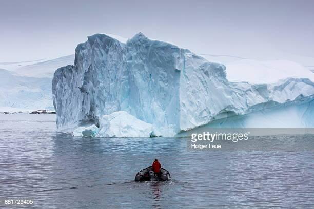 Cruise ship MV Sea Spirit Zodiac raft and iceberg