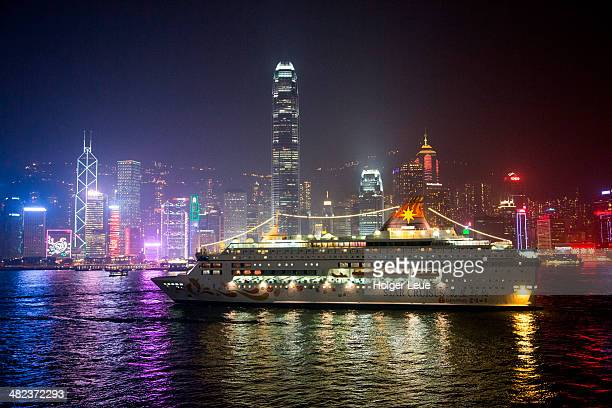 Cruise ship Pisces and skyline at night