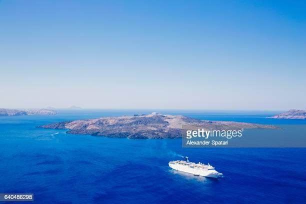 Cruise ship sailing near volcano of Santorini island, Cyclades, Greece