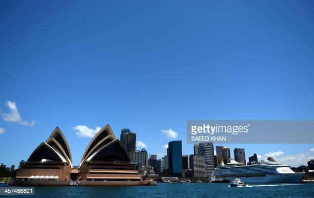 A cruise ship sails in front of the Sydney's iconic land mark the Opera House on December 18 2013 Australia's central bank is keeping an 'open mind'...
