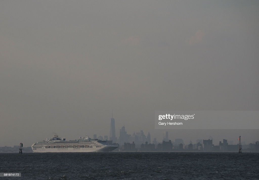A cruise ship sails past the skyline of Lower Manhattan in New York City on July 21 2016 as seen from Sandy Hook NJ