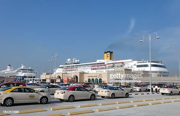 Cruise Terminal at Port Rashid in Dubai in the UAE with taxis and new ships in United Arab Emirates
