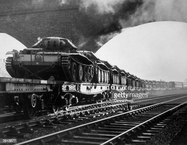 Cruiser Tank MK IV tanks being transported by rail somewhere on the LNER network Such trains had right of way and passenger services were often...