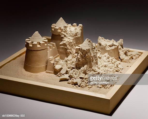 Crumbled sand castle in sand box, studio shot
