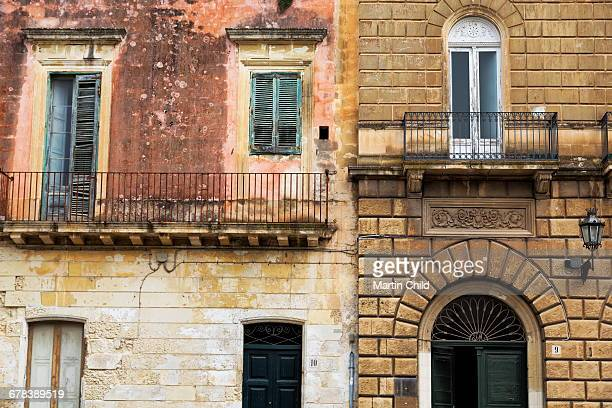 Crumbling houses in the baroque city of Lecce, Puglia, Italy, Europe