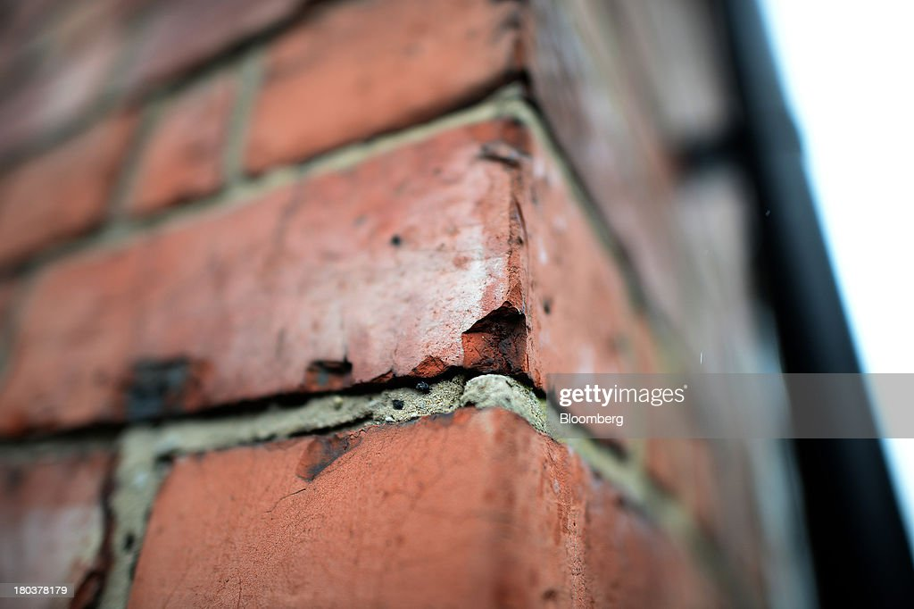 Crumbling mortar sits on the brick work of a terraced residential property in Newcastle-upon-Tyne, U.K., on Wednesday, Sept. 11, 2013. U.K. house prices rose for a seventh month in August and will probably continue to increase through the rest of the year, according to a report by Halifax. Photographer: Nigel Roddis/Bloomberg via Getty Images