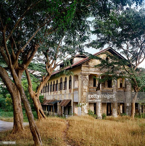 Crumbling old colonial buildings and sprawling stately homes are found all over the city of Mawlamyine also known as Moulmein reflecting their...