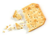pieces and crumbs of cracker macro isolated on white background