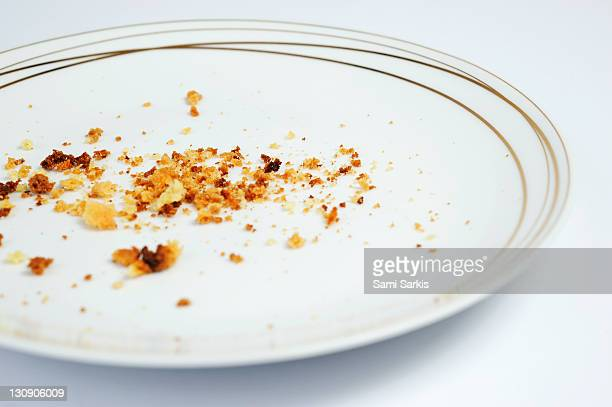 Crumbs in white plate
