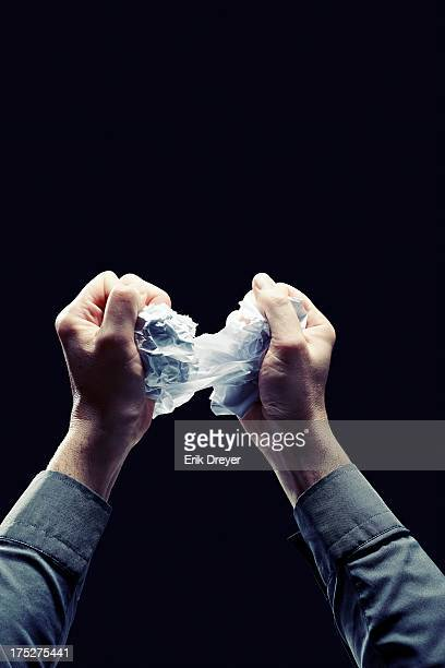 Crumple and rip paper with hands