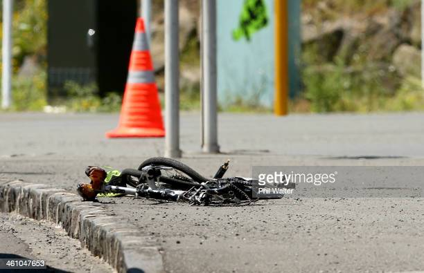 A crumpled bike is pictured on the side of the road after a cyclist was fatality wounded at the bottom of Parnell Rise on January 7 2014 in Auckland...