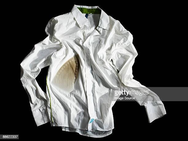 A crumpled burned white shirt