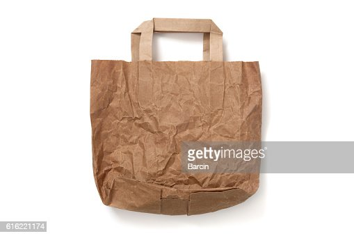 Crumpled empty brown paper shopping bag on white background : Stock-Foto