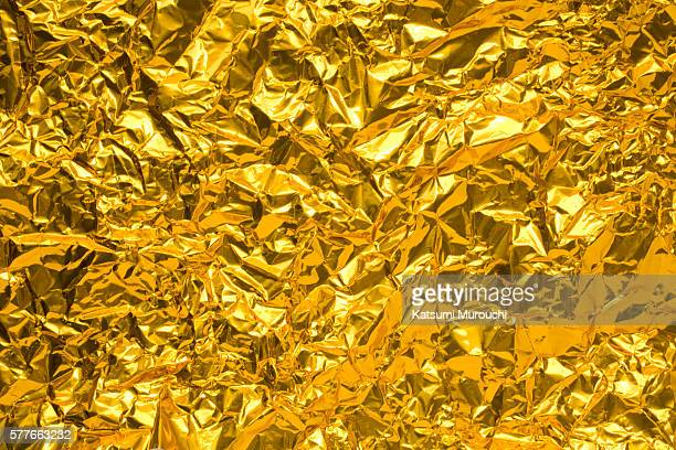 Crumpled gold paper texture background