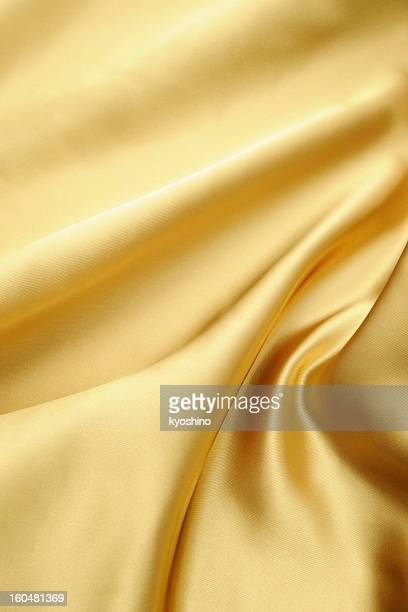 Crumpled gold satin texture background