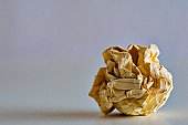 Crumpled lined paper ball.