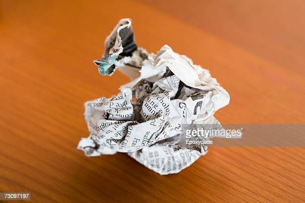 Crumpled newspaper on a table
