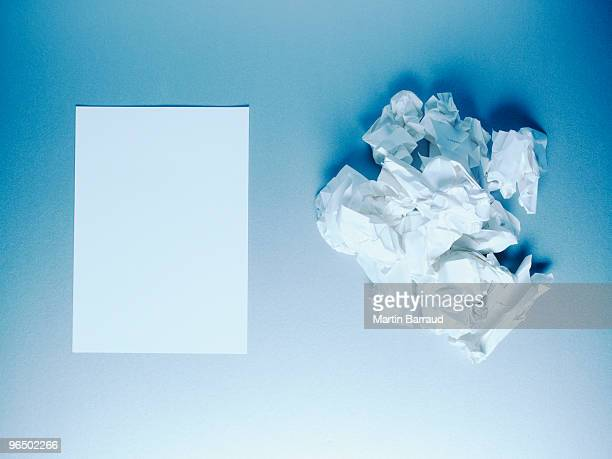 Crumpled paper balls and notepad