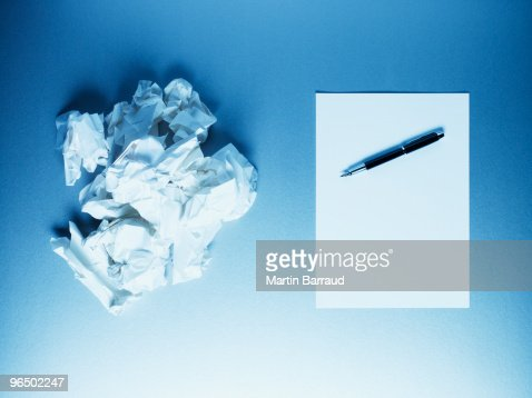 Crumpled paper balls with notepad and fountain pen : Stock Photo