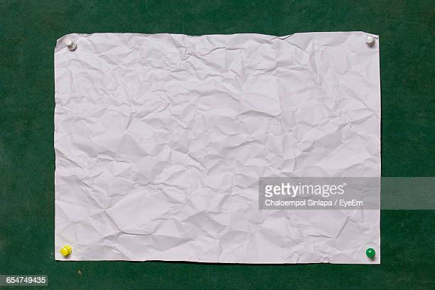 Crumpled Paper On Bulletin Board