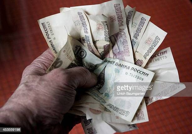 Crumpled Russian rubles banknotes in a hand on August 13 2014 in Bonn Germany