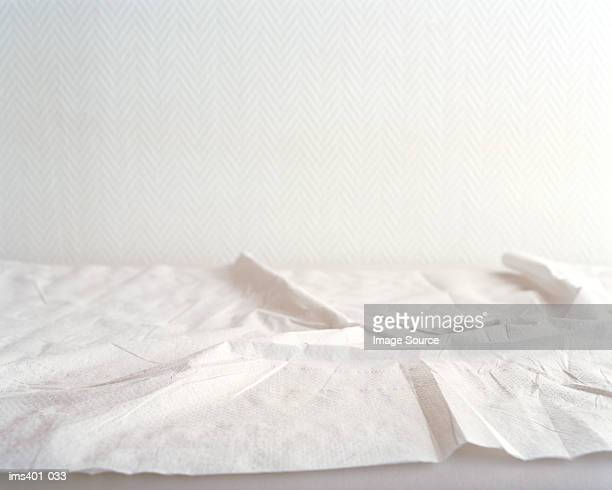 Crumpled sheets on hospital bed