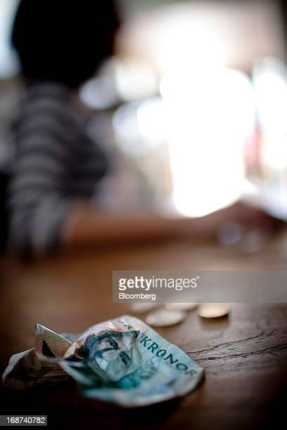 A crumpled Swedish kronor note is seen in this arranged photograph in Malmo Sweden on Tuesday May 14 2013 Sweden's krona sank after a report showed...