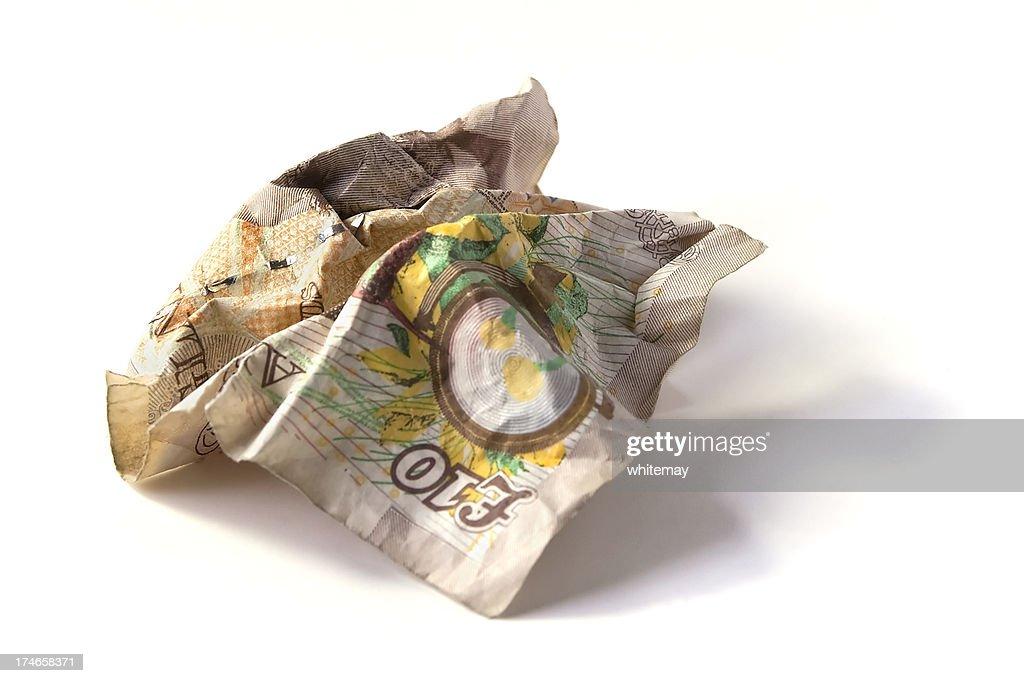 Crumpled ten pound note