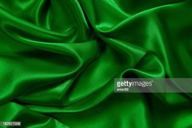 Crumpled up green satin fabric